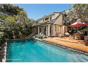 Coral fringed, sparkling pool and entertaining area with classic
